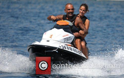 Christian Audigier and his girlfriend Nathalie Sorensen take...