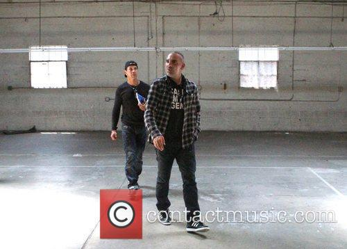 Christian Audigier  visits a new building in...