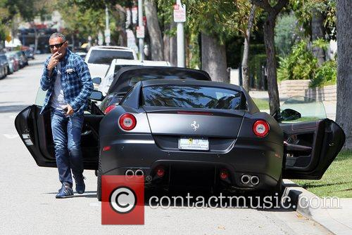 Christian Audigier and his girlfriend drive his matte...