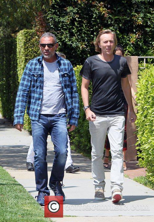 Christian Audigier and his girlfriend look at houses...
