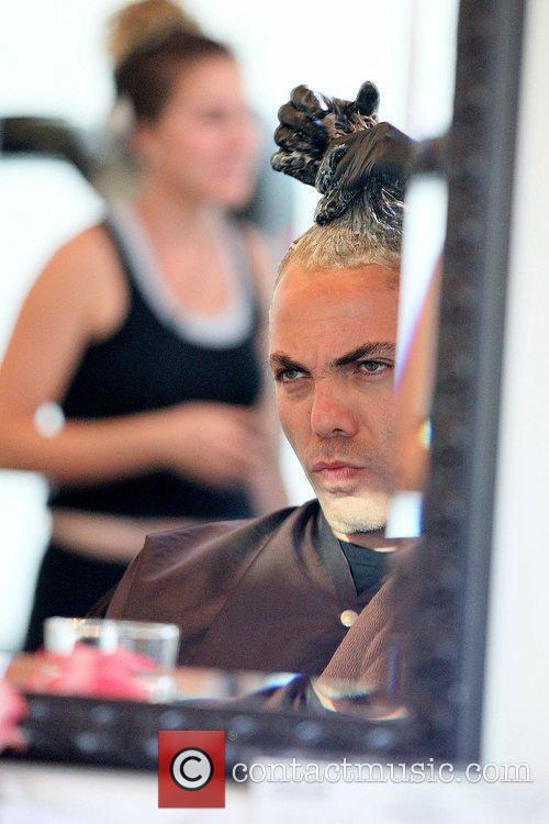 Mexican pop singer getting his hair dyed at...