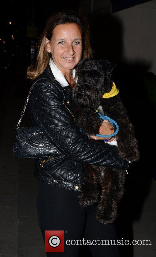 Leaving George Club with her dog after attending...