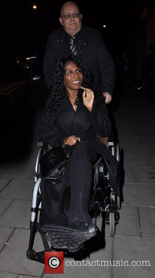 Arriving at C restaurant in a wheelchair following...
