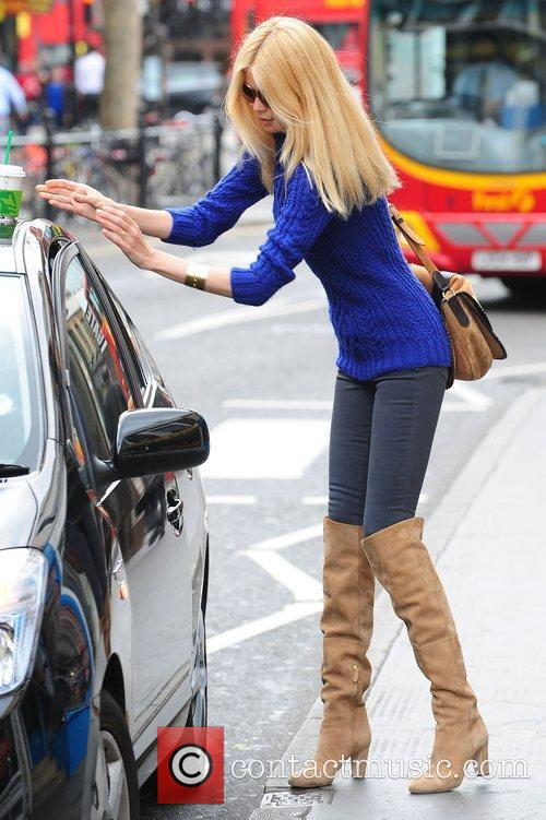 Claudia Schiffer grabs a coffee from Starbucks in...