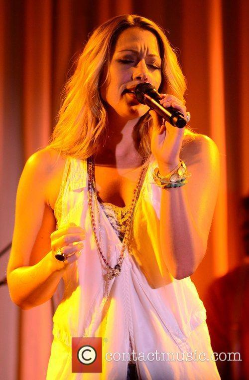 Performs at her CD release party for her...