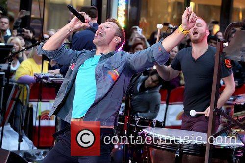 Chris Martin and Will Champion Coldplay performing live...