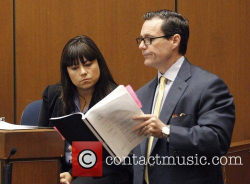 Is shown documents by defense attorney Ed Chernoff...