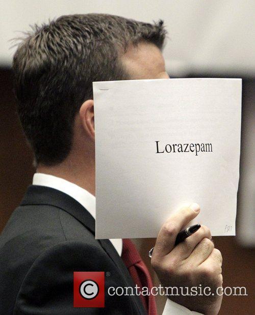 Deputy district attorney David Walgren holds documents on...