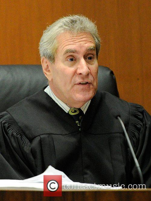 Judge Michael Castor gives preliminary instructions to jurors...