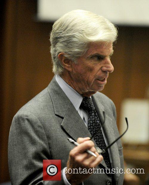 Defense attorney J. Michael Flanagan questions Dr. Paul...