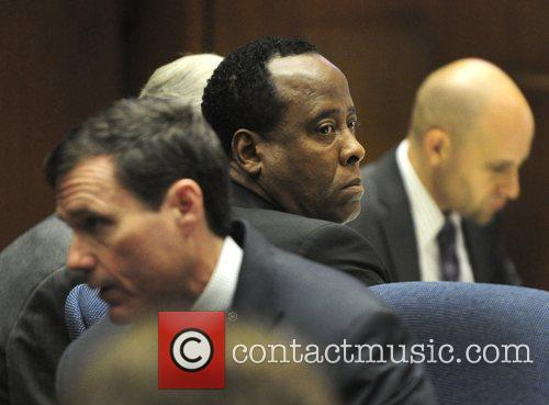 Dr. Conrad Murray is surrounded by his attorneys...