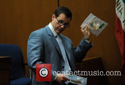 Defense Attorney Ed Chernoff holds up evidence for...