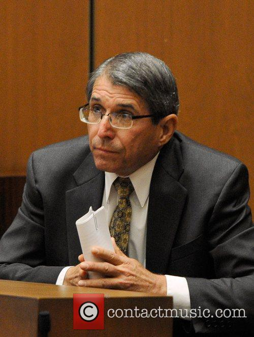 Defense witness Dr. Paul White  pauses during...