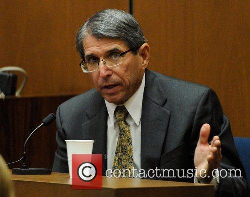 Defense witness Dr. Paul White  testifies during...
