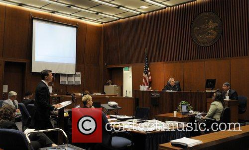 Deputy District Attorney David Walgren cross-examines Dr. Paul...