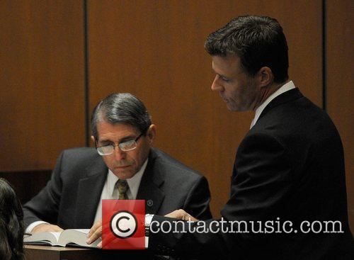 Dr. Paul White and Deputy District Attorney David...