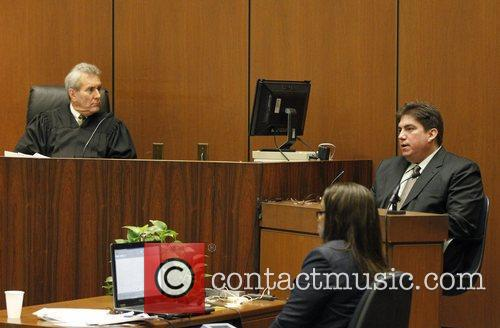 Judge Michael E. Pastor listens to prosecution witness...