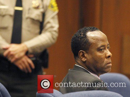 Dr. Conrad Murray  sits in court during...