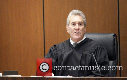 Judge Michael E. Pastor addresses the courtroom during...