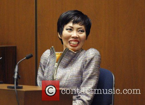 Cardiologist Dr. Thao Nguyen smiles toward the jury...