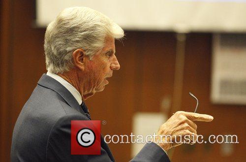 Defense attorney J. Michael Flanagan  gestures as...