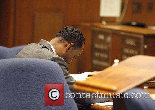 Dr. Conrad Murray looks down at the defense...