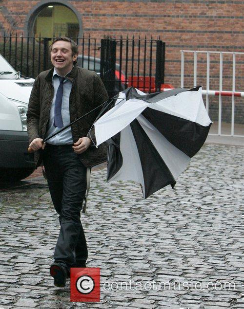 Craig Gazey has problems with his umbrella 'Coronation...