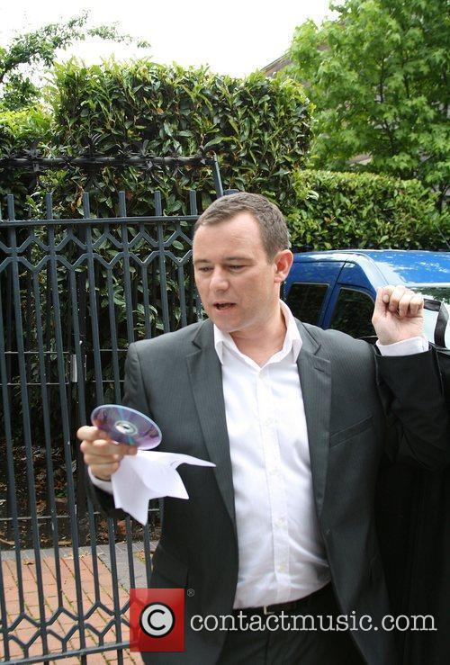 Andrew Lancel with a Ted Baker suit carrier...
