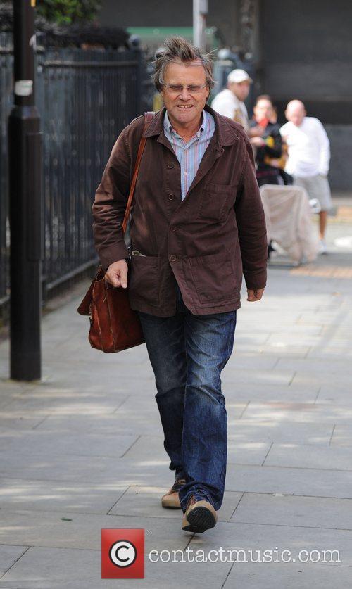 Looking windswept as he leaves the Granada Studios...