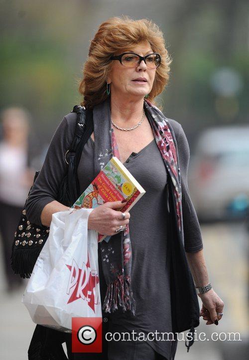 Arrives at Granada Studios to film 'Coronation Street'