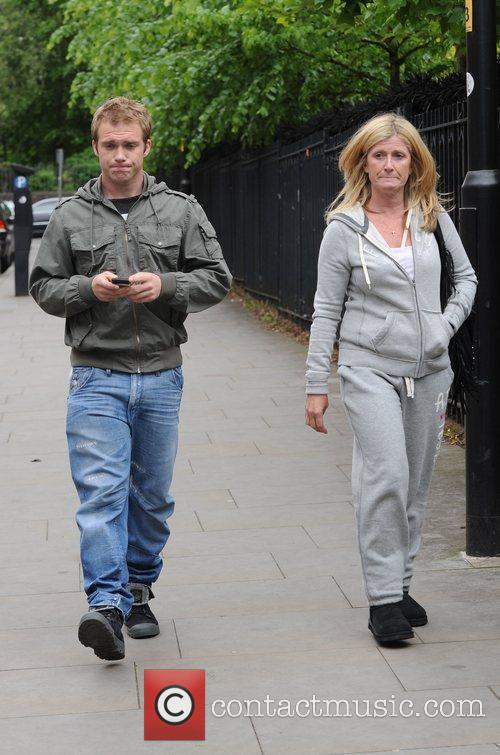 Chris Fountain and his mother  arrive at...