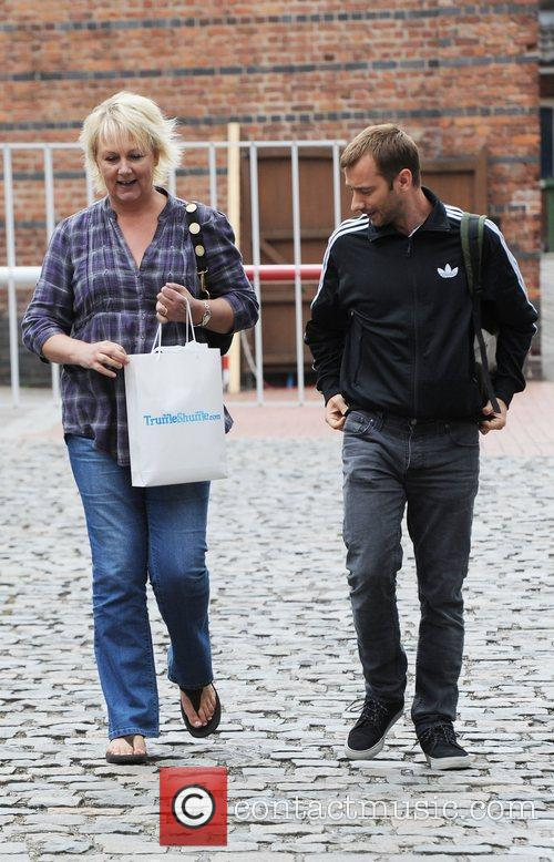 Sue Cleaver and Charlie Condou leave the Coronation...