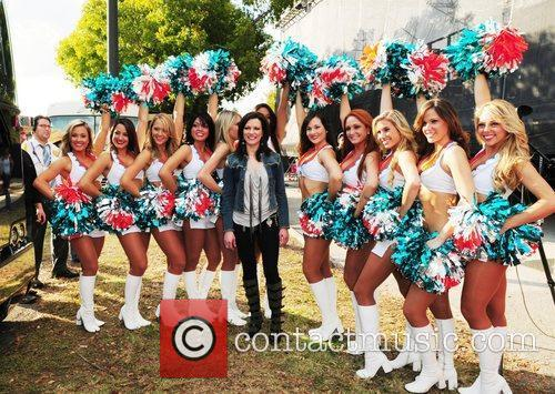 Martina McBride poses backstage with the Miami Dolphin...