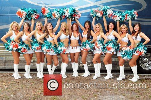 Miami Dolphin cheerleaders KISS Country Chili Cookoff at...