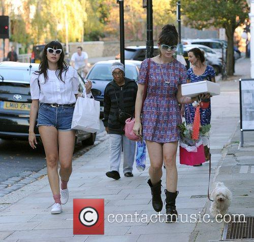 Daisy Lowe and a female companion walking her...