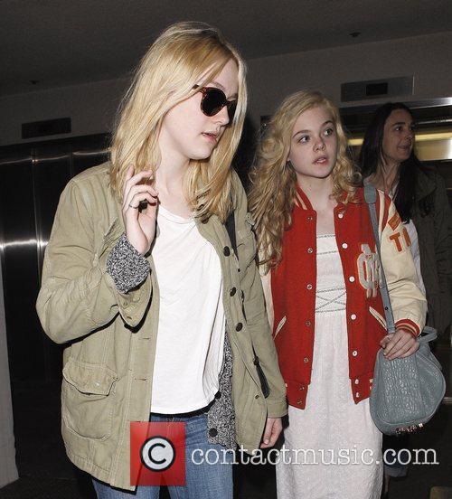 Dakota Fanning and Elle Fanning arriving at LAX...