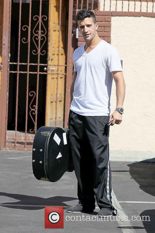 Mark Ballas holding his guitar case 'Dancing with...