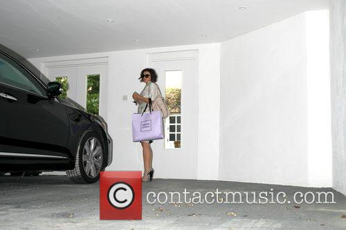 Dannii Minogue arriving back at her sister's home...