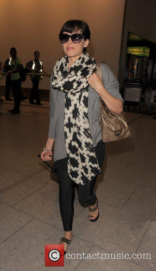 Dannii Minogue  arriving at Heathrow Airport. London,...