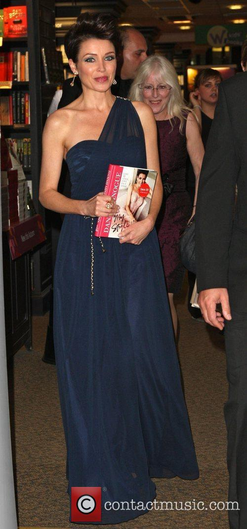 Signs copies of her book 'My Style' at...