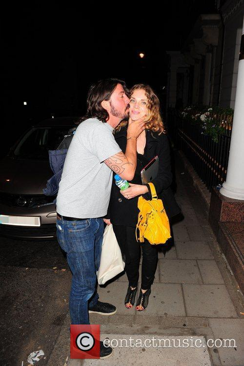 Dave Grohl plants a kiss on his wife...