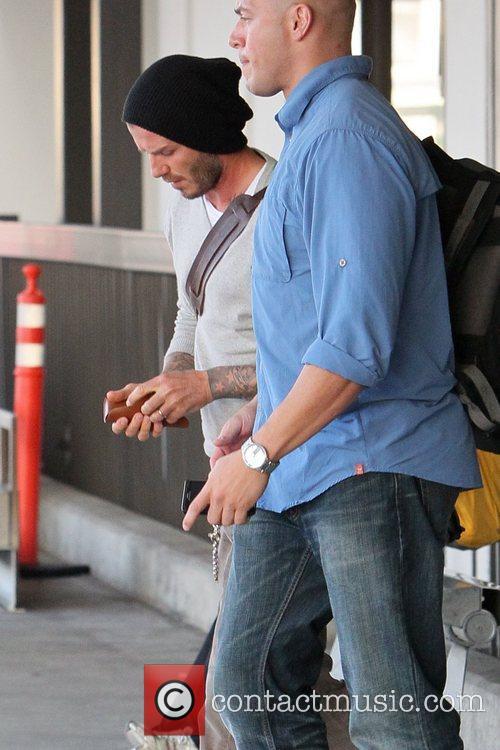 david beckham arrives at lax airport separately 5743397