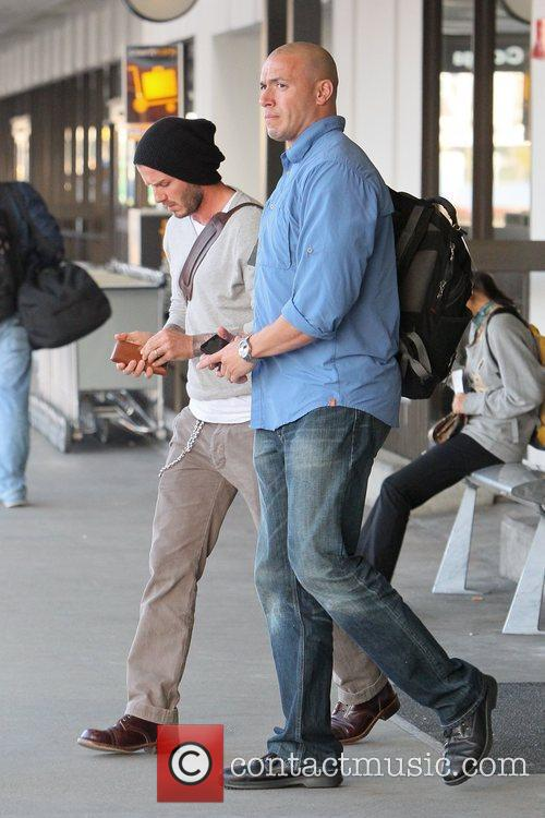 david beckham arrives at lax airport separately 5743402
