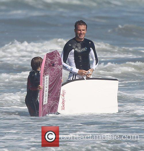 David Beckham  bodyboarding with son on Malibu...