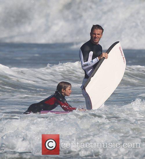 David Beckham  bodyboarding with his son Romeo...