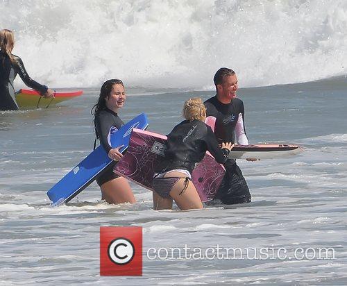 Megan Ramsay and David Beckham  bodyboarding on...