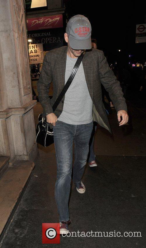 David Tennant attempts to hide from photographers, as...