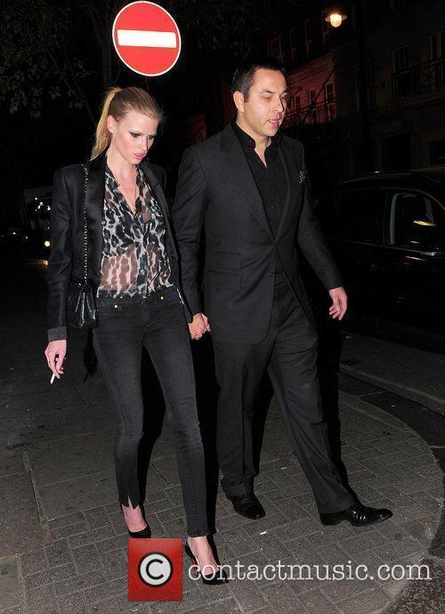 David Walliams and Lara Stone holding hands as...