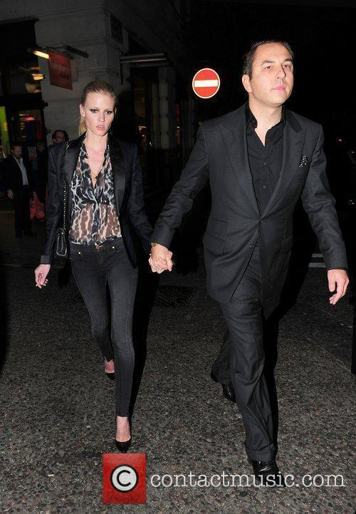 David Walliams and Lara Stone holding hands as...