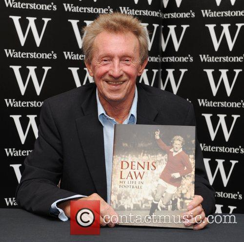 Denis Law  signs copies of his book...